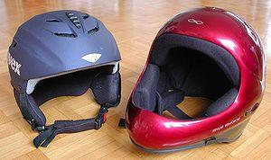 A typical ski helmet (left) and paragliding helmet