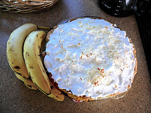 Banana cream pie and four bananas.