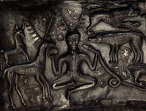 English: Detail of antlered figure holding a s...