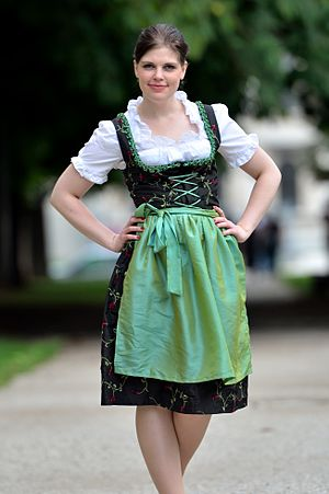 Dirndl with cording and green apron Deutsch: D...