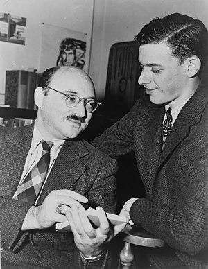 Ellery Queen (left), American mystery writer, ...