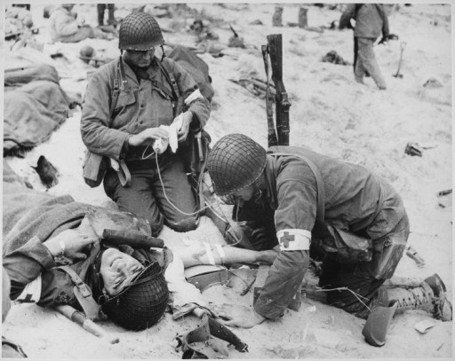 Medics helping injured soldier in France, 1944 - NARA - 535973