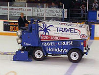 An ice resurfacer lays down a layer of clean w...