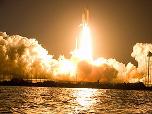 The Discovery space shuttle lifting off on the...