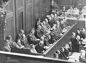 The defendants in the dock on the first day (A...