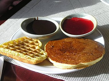 Pancake and waffle, served with sauces. Photo ...