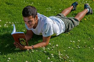 English: Boy Reading a Wikpedia-Book from Pedi...