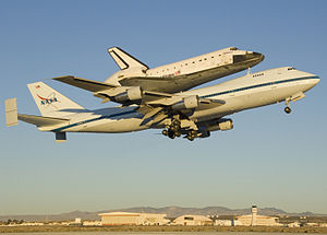 English: The Space Shuttle Endeavour atop its ...