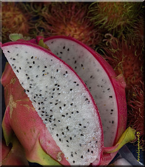 Some Dragon Fruit sliced at the market, with a...