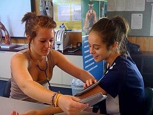 English: taking blood pressure in PE