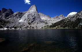Pingora Peak rises above Lonesome Lake in the Cirque of the Towers in the Popo Agie Wilderness