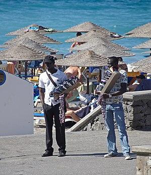 Salesmen of sunglasses, etc. at the beach of C...