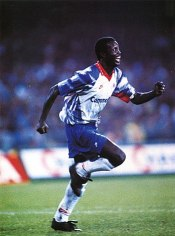 Weah's celebrating his goal during the match between PSG and Napoli in the second round of 1992–93 UEFA Cup