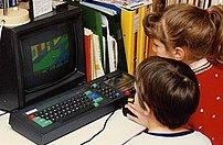 Children playing Paperboy on an Amstrad CPC 46...