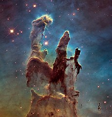https://i0.wp.com/upload.wikimedia.org/wikipedia/commons/thumb/6/68/Pillars_of_creation_2014_HST_WFC3-UVIS_full-res_denoised.jpg/230px-Pillars_of_creation_2014_HST_WFC3-UVIS_full-res_denoised.jpg