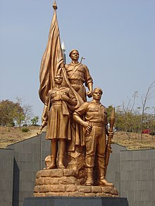 Statues atop the tomb of the Unknown Soldier at Heroes' Acre; the monument was designed by North Korean architects who reported directly to Mugabe[160]