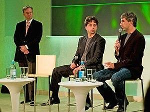 Left to right, Eric E. Schmidt, Sergey Brin an...