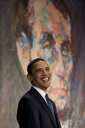 President Barack Obama in front of a portrait ...