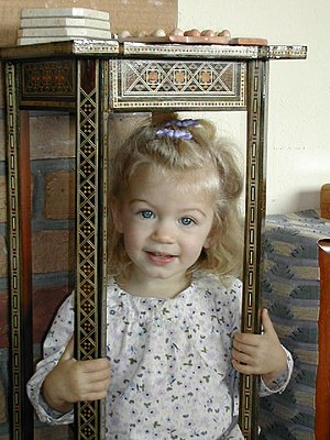 Cute little girl sitting.