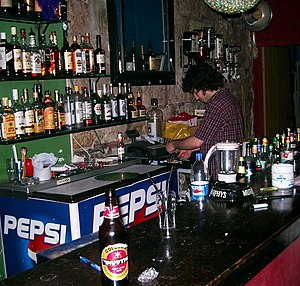 A bartender at work in a pub in Jerusalem, Israel.