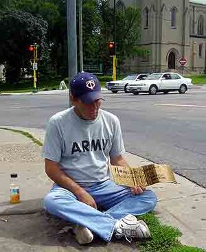 Beggar in front of Walker Art Center, Minneapo...