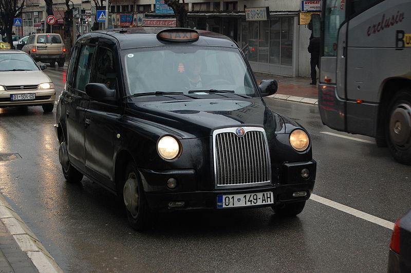 File:Black taxi cab 01 149-AH in Pristina.JPG