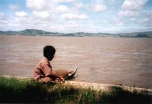 Boy at the Irrawaddy river in Myanmar