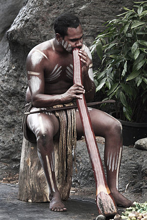 Playing the traditional aboriginal musical ins...