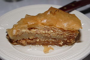 A plate with one piece of baklava.