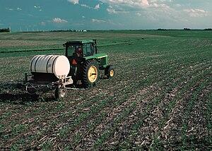 View of nitrogen fertilizer being applied to g...