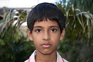 English: A serious faced boy