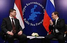Medvedev with Latvian PM Valdis Dombrovskis, April 2013