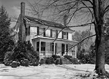 A black and white photograph of a two-story colonial home formerly belonging to Francis Nash and, after Nash's death, to William Hooper