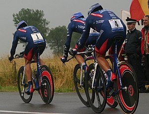 Lance Armstrong (left, #1) leads the U.S. Post...