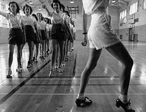 Tap dancing class in the gymnasium at Iowa Sta...