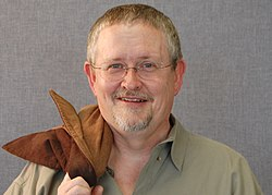 Orson Scott Card looks like most science fiction authors. Kinda geeky.