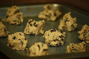 Raw cookie dough in cookie clumps.