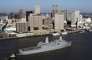The USS New Orleans (LPD-18) passes by downtow...