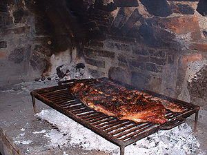 This is a traditional asado. The picture shows...