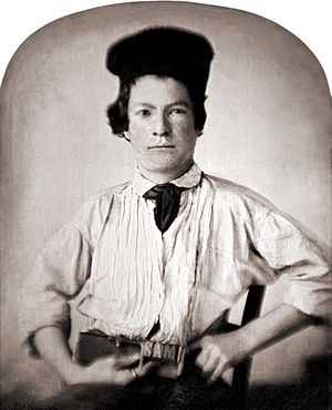 Portrait of Samuel Clemens as a youth holding ...