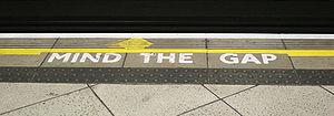 "London underground, mark ""Mind the gap""."