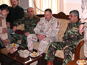 Iraqi Armed Forces Chief Gen. Babakir (left) a...