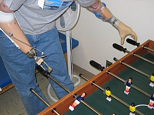 A soldier in the U.S. Army plays fooz-ball wit...