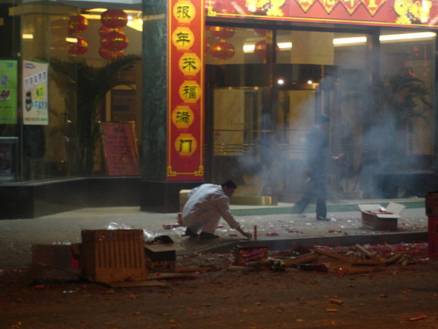 A Chinese man setting off fireworks during Chinese New Year in Shanghai.