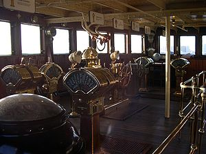 Several engine order telegraphs on the bridge ...