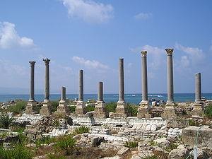 Remains of ancient columns at Al Mina excavati...
