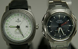 English: The watch on the left has a mechanica...