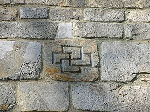 English: Double swastika from the wall of the ...