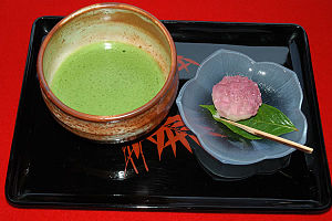 A tray with a prepared bowl of matcha (Japanes...