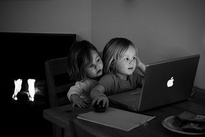 English: This picture is of two children on a ...
